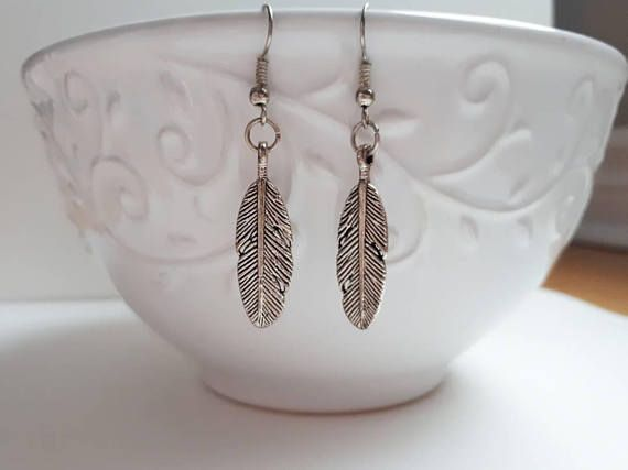 Check out this item in my Etsy shop https://www.etsy.com/ca/listing/576522349/silver-feather-dangle-earrings