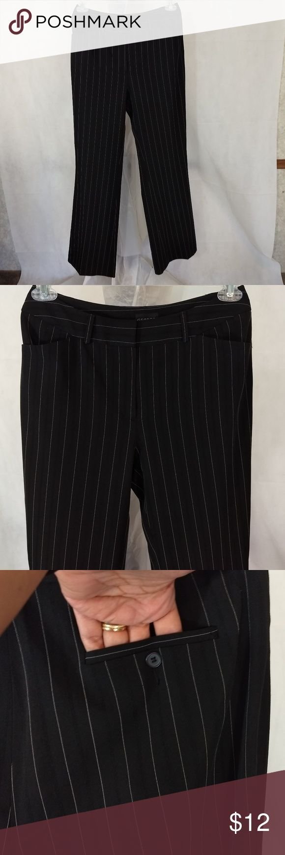 GEORGE Career Pants Women Size 8 Average Black Whi ITEM DESCRIPTION: George Stretch Wide Leg Career Dress Pants Women Size: 8 Average Color: Black White Pattern: Pin Stripe Closure: Button, Hook and Zipper Fabric: 93% Polyester 6% Spandex 1% Rayon Made in: Indonesia ITEM CONDITION:  Pre-owned...GREAT USED CONDITION! ITEM MEASUREMENTS (Laying flat): Waist:  15 in                    Hips: 20 in Inseam: 31.5 in Rise: 10 in George Pants Wide Leg