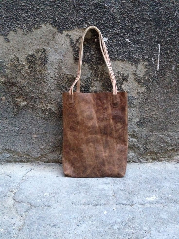Handmade leather totebag with upcycled cotton straps. Durabe, and will get even nicer while aging.dimensions (approx.) width: 30 cmheight: 38 cm depth: 5 cm 80 �