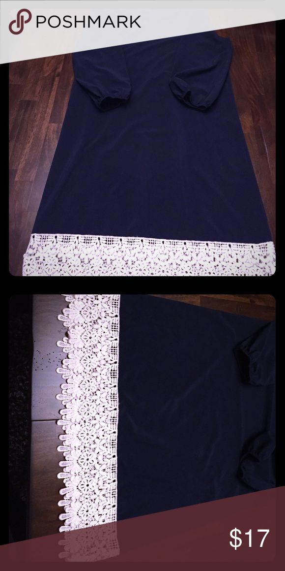 "Never worn - Blue sundress with white lace fringe Never worn - Navy blue scoop neck sundress with 3/4 length sleeves and white lace fringe at bottom. Dress hits at the knees (I'm 5'6"".) and is 100% polyester. White Plum Dresses Midi"
