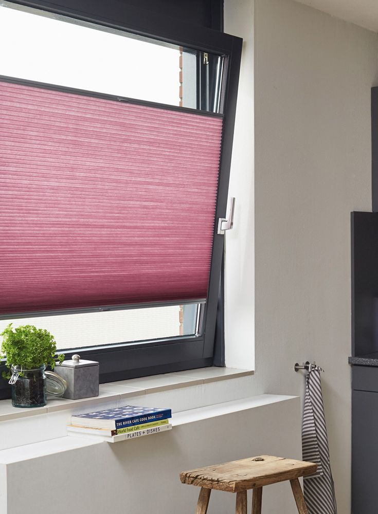 Our Luxaflex® Duette® Shades are the perfect kitchen blind, giving privacy, light control and ventilation for busy cooks. This range not only comes in this stylish pink blind but in lots of other stunning colours and transparencies.