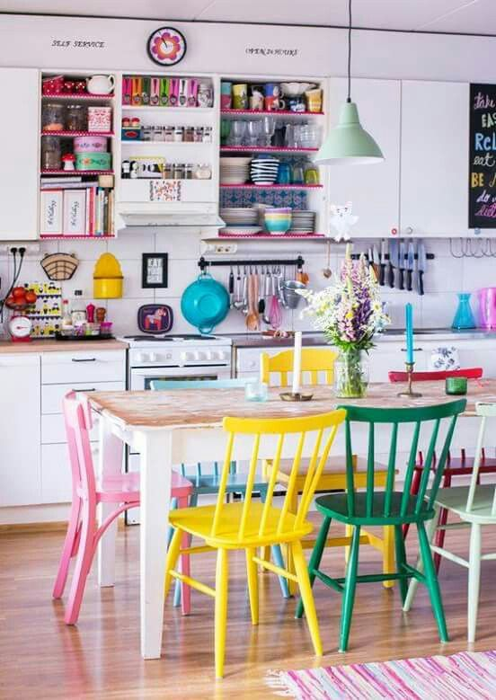 This colourful kitchen with painted dining chairs makes me smile. It would be such a happy place to cook! Love how the colour pops against the white cabinets and wooden floors.