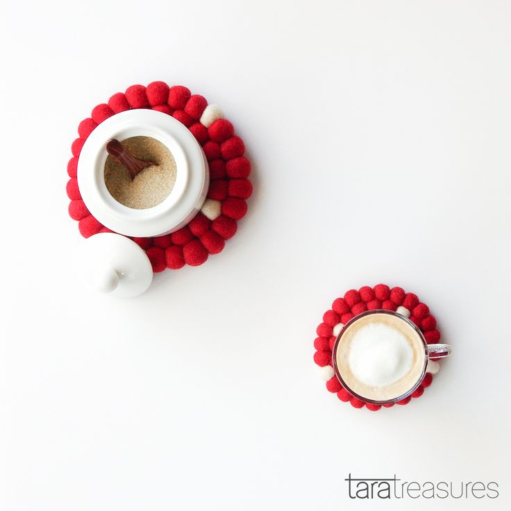 Flat lay of Nespresso latte with Sugar bowl. Red with White Dots teapot and cup coasters from our market stall.