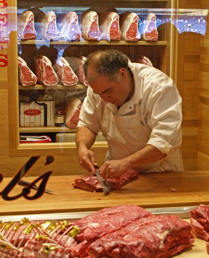 One of Lobel's butchers slicing meat at the demonstration butcher shop in Yankee Stadium.