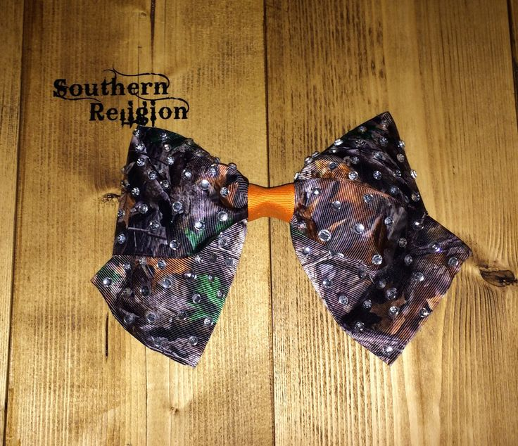 A personal favorite from my Etsy shop https://www.etsy.com/listing/494229922/camo-sparkly-cheer-bow