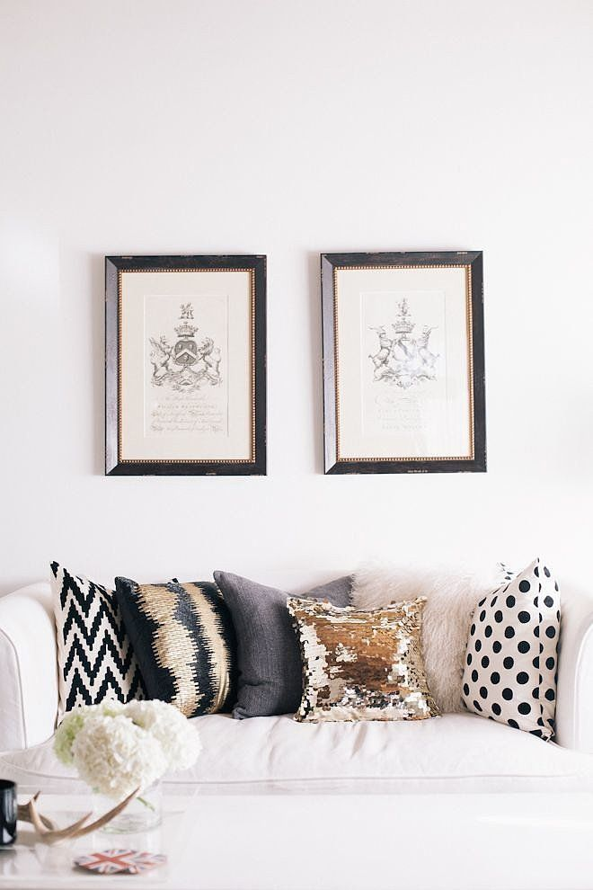 Warm living room with a beige sofa and an array of printed and metallic throw pillows
