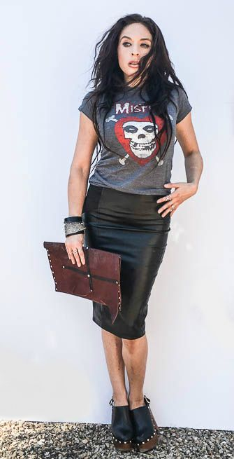 Rock the band tee. Black faux leather pencil skirt and band T shirt rocker outfit paired with one of our handcrafted leather rocker clutch bags