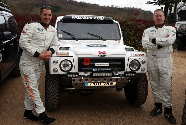 Part of the Race2Recovery team of injured soldiers and civilians (L-R) Mark Zambon and Ben Gott, pose besides the vehicle that they are ente...