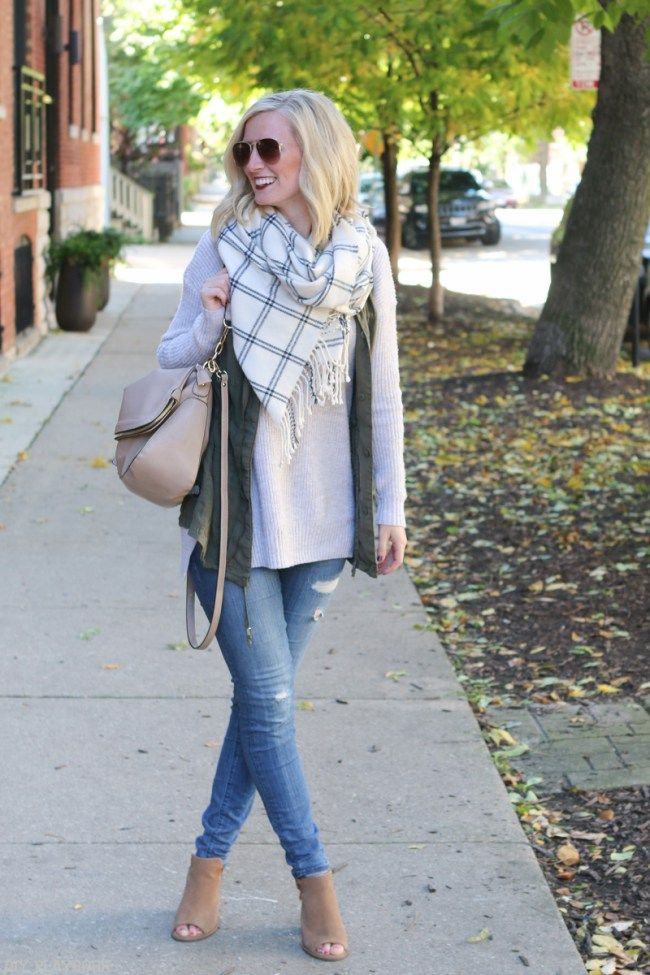 Love this look for fall. A sweater, vest, and chunky scarf for the chilly days. Such a cute outfit for the season.