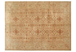 perhaps instead of a white fluffy rug, a light, earth toned old persian rug?