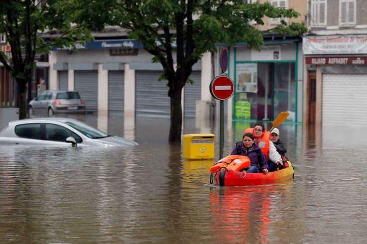 Residents use a canoe to evacuate in downtown Nemours, 50 miles south of Paris…