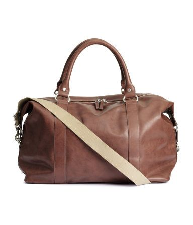 Weekend bag in imitation brown leather with two handles and a zip ...