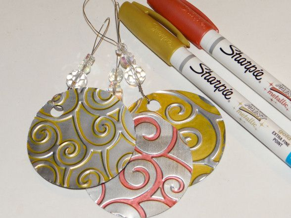 Eco-craft ornaments: Empty aluminum soda cans embossing supplies for hand embossing or a machine that will emboss Sharpie Metallic Markers- fine or extra fine point 2 inch circle punch 1/4 inch hole punch wire beads
