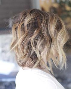Side view of layered balayage messy bob haircut for thick hair