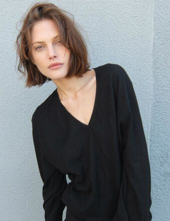 Catherine McNeil- she has a good look. Cropped hair cut, natural face.