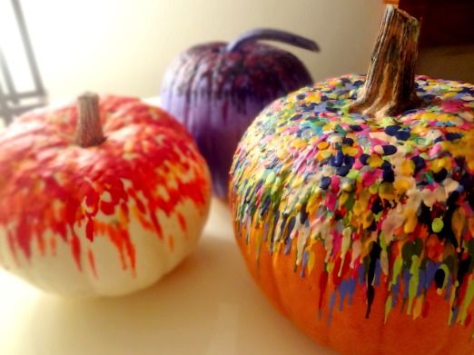 Melted crayons on pumpkins.  Looks AWESOME!