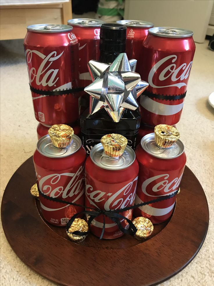 made this for my boyfriend's 21st birthday I used 11 coke cans, one bottle of jack, and then topped it off with Reese's because they are his favorite I spent forever saving a bunch of pins that inspired me so I figured I would post my final product