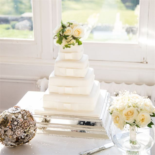Jon And Sky Cut Into An Elegant Four Tiered Wedding Cake From Marks Spencer