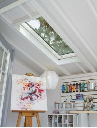 Inside there's ample storage for paint, brushes, and the works, while ceiling skylights allow natural light and nature to peek through.
