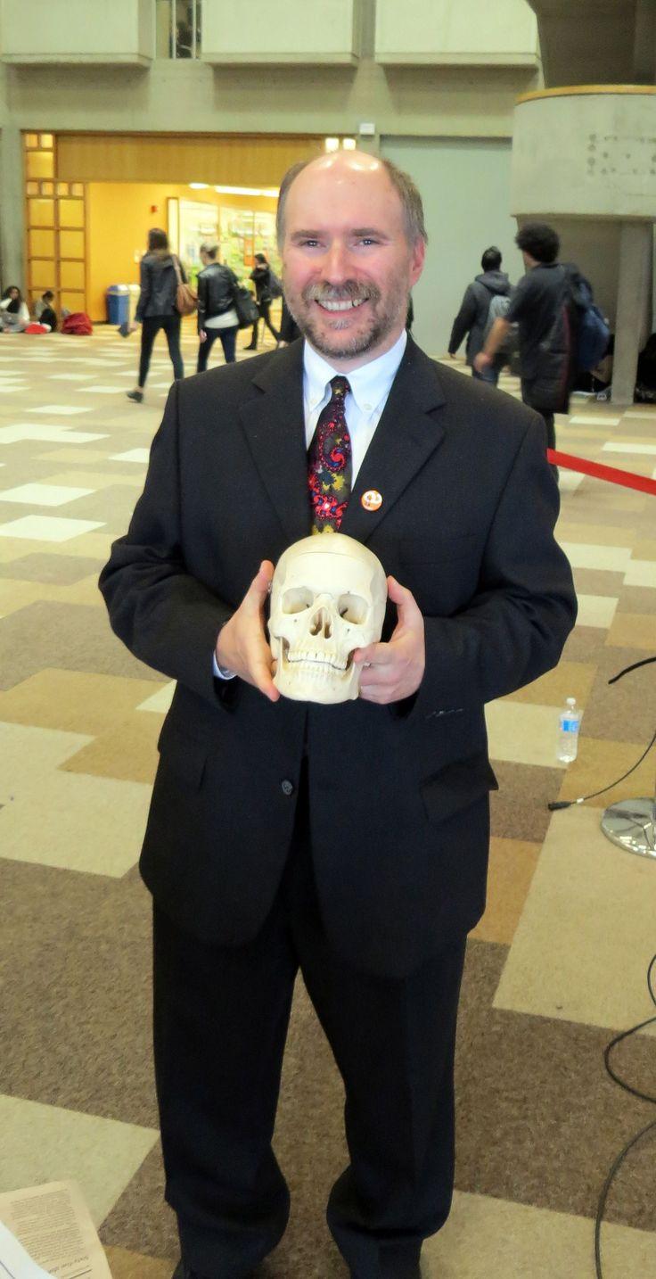 John Dupuis & skull - Death of Evidence in #Canada, Oct.22 #YorkU #RIPevidence #OAweek