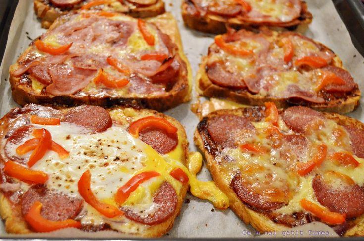 Pizza pe felii de paine
