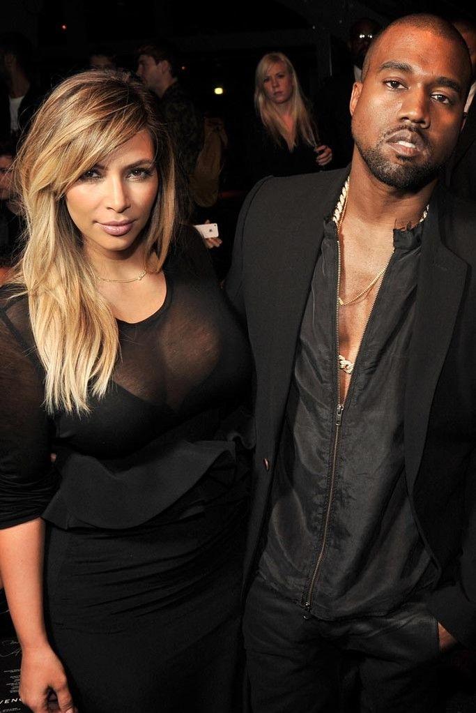 Kim Kardashian, Kanye West Front Row at Givenchy  [Photo by Stéphane Feugère]