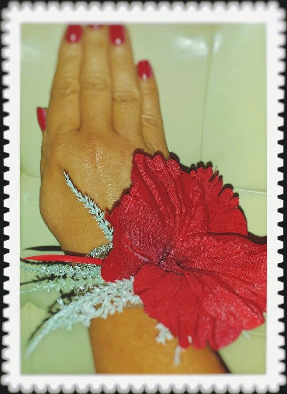 Red silk flower & silver corsage for a wedding guest or prom
