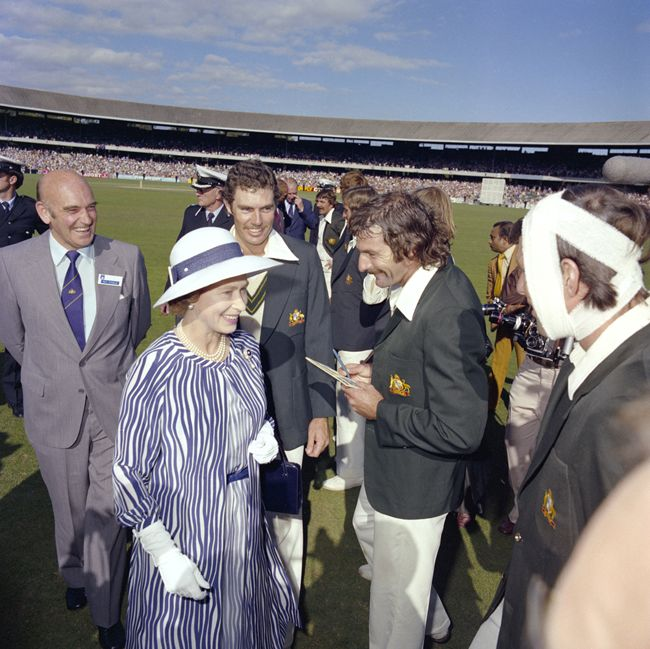 The Queen with cricketers Dennis Lillee and Australian captain Greg Chappell at the Centenary Test at the Melbourne cricket ground, March 1977. Australian batsman Rick McCosker, with bandaged head, and Ray Steele, Treasurer of the Australian Cricket Board look on.