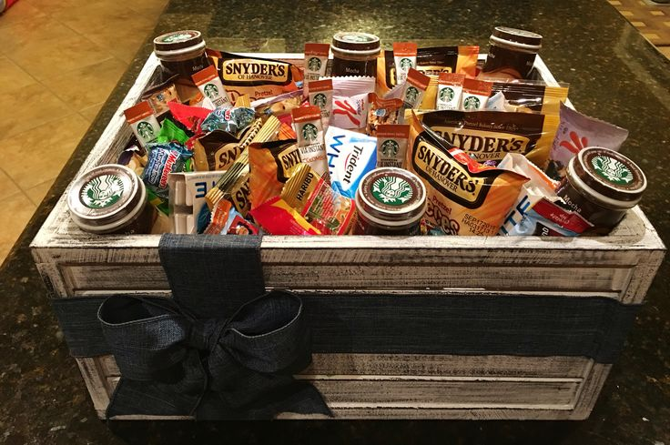 Thank you gift basket I made for our awesome nurses ❤️ 1.  Crate from craft store 2.  I hot glued the ribbon onto           the crate (wire ribbon holds        its shape nicely).  3.  Lined crate with shredded        paper. 4.  Filled crate with goodies that        staff could grab and have as        snacks, gum, coffee,        treats...:)