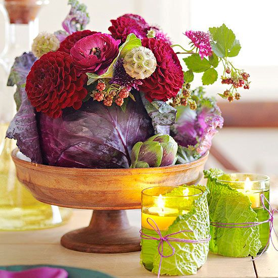 Centerpiece Basket with Fall Elements -vase for a head of dramatic purple cabbage. Hollow out the center with a metal spoon or pineapple corer, then place wet florist's foam or a small jar of water inside. Loosely arrange flowers -- peonies, roses, dahlias & more. Wrap clear votive holders with napa cabbage leaves