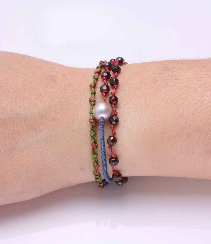Three row faceted garnet bracelet, with silver clasp, twisted and woven threads, decorated with semiprecious stones.