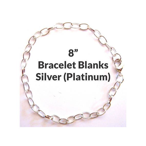 8in Charm Bracelet Blanks - Silver (Platinum)  Listing Quantity: Sold in lots of 5 or 25 Color: Silver (Platinum) Overall Length: 8 Link Size: 7mm Long x 4.5mm Wide x 1mm Thick Ships In: Same or next business day Shipping: $3.50 Flat Rate Shipping (US) Base Metal: Iron Closure: Lobster claw clasp and jump ring Note: There is very little difference between the Platinum and Sterling silver colors; however, platinum leans more stainless steel and sterling silver finish has a whiter, more matte…