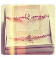 Set due braccialetti in cotone intrecciato e simbolo BeA legami in argento placcato oro rosa.