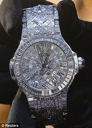 Hublot's watch, which has a price tag of USD5,000,000 dazzles with a staggering 140 carats of diamonds, all set in white gold.