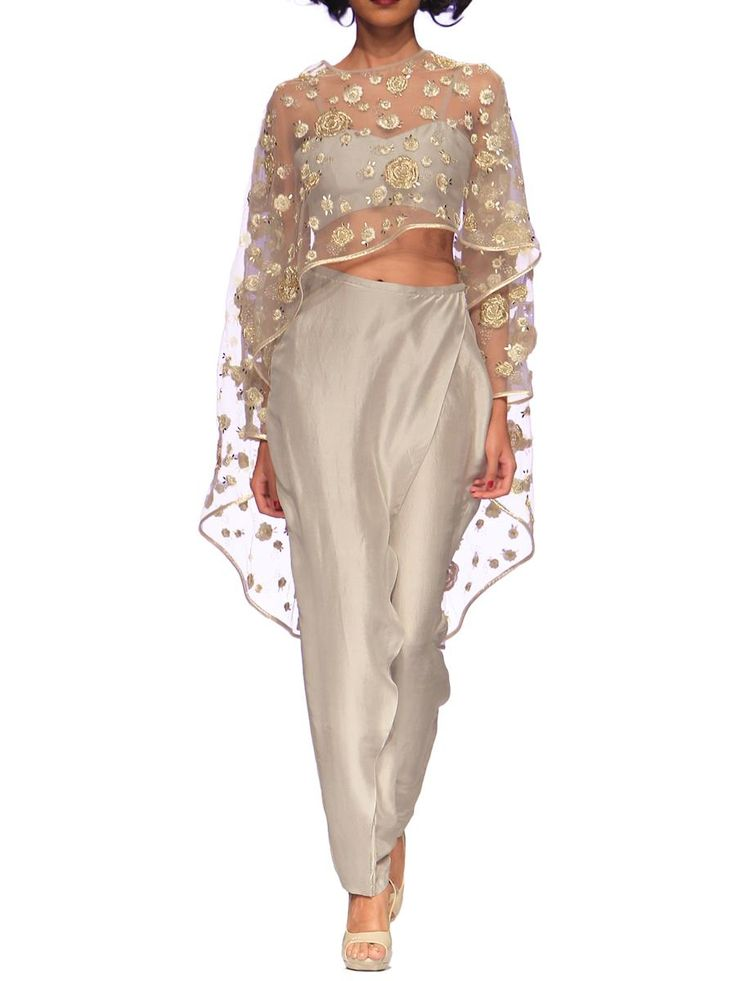 Payal Singhal's whimsical Pale Grey Rose Embroidered Cape has underlying Bustier. Turning her eye for precision and drama she delivers this luxe indian suit in the form of this cape top, exquisitely cut suit. Crafted in an elegant hue of grey with accompanying low crotch overlay pants. - See more at: http://www.byelora.com/Shop/Payal-Singhal/Eve-Cape-Indian-suit#sthash.sst8PAnC.dpuf