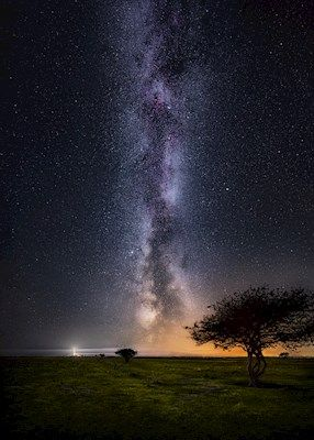 The Milkyway in purple and orange above the Schäferiängarna. Photograph by Jörgen Tannerstedt, available as poster at printler.com, the marketplace for photo art.