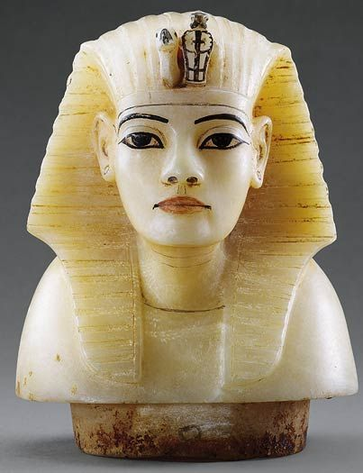 Amarna period alabaster canopic stopper. It is not precisely known which of the late 18th dynasty kings is portrayed here, although it was found in Tutankhamen's tomb.