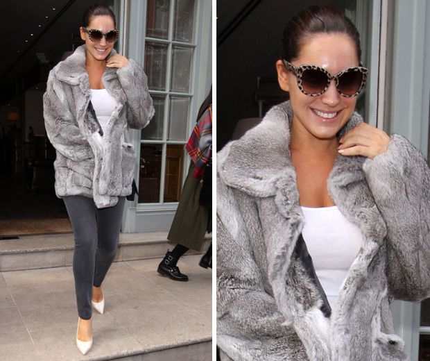 Kelly Brook works muted greys out in London by teaming a faux fur coat with grey skinnies