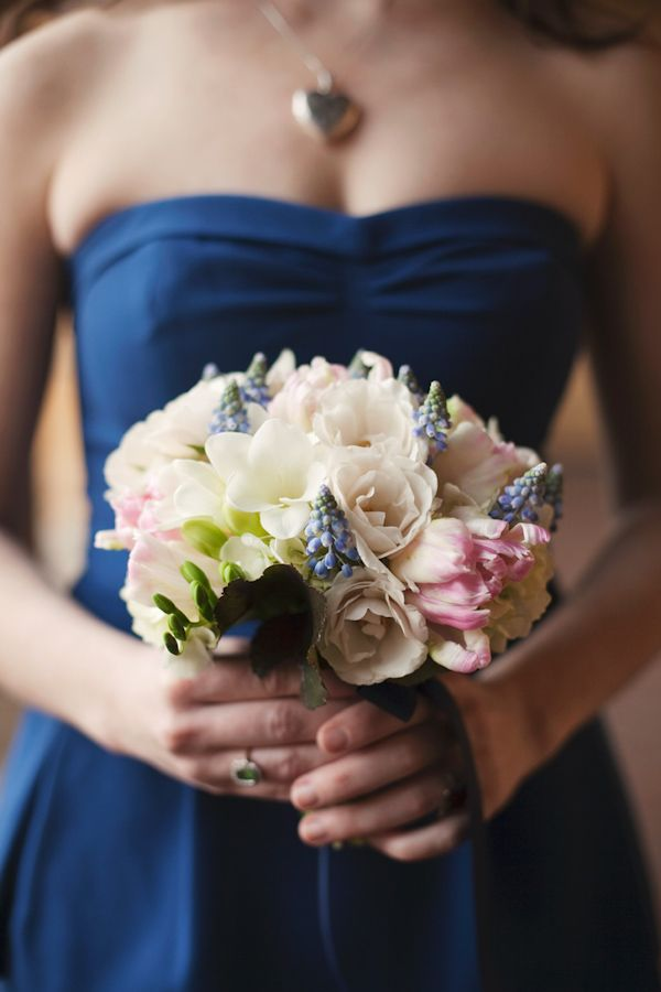Love the navy dress combined with the ivory, light pink and light blue bouquet. Photo by Stephanie Williams via JunebugWeddings.com.