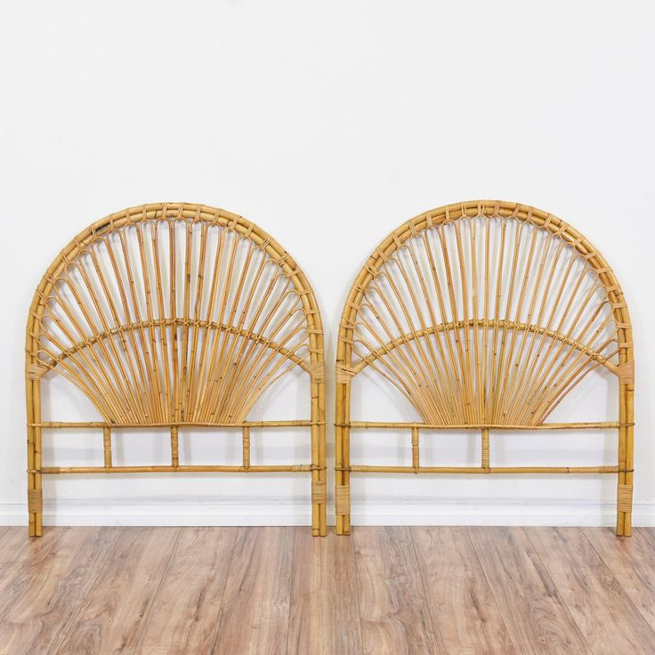 This pair of tropical headboards are featured in a curved rattan with a light wood finish. These twin sized headboards are in great condition with curved tops, fan shaped railings and woven details. Beach chic beds perfect for a guest bedroom! #tropical #beds #headboard #sandiegovintage #vintagefurniture