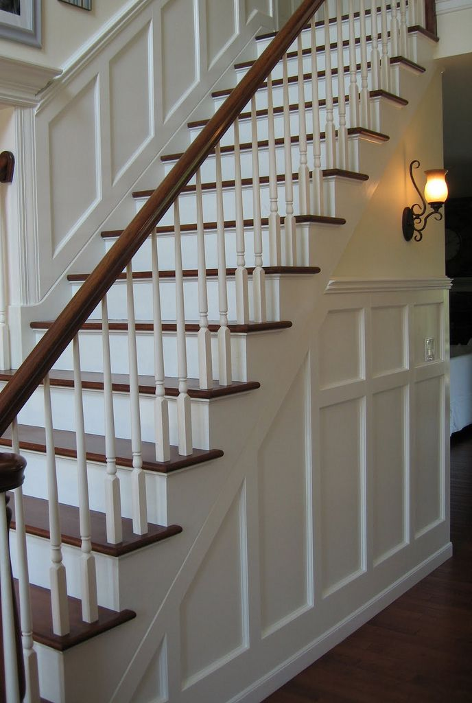 Wood Staircase. Wainscoting. Sconce. Foyer.