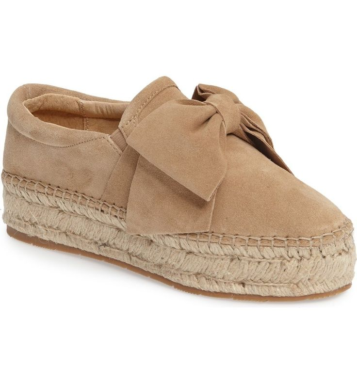 An exaggerated bow and lofty espadrille platform add breezy sophistication to this lush suede slip-on.