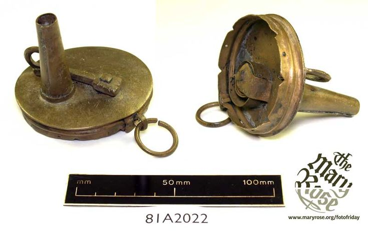 This is one of four copper alloy powder horn lids probably used to prime the large bronze and iron guns of the Mary Rose (This is one example, shown twice so you can see the mechanism). The nozzle has an internal spring-loaded cover, operated by lever on the outside, which ensures that every time the horn is used, the same amount of powder is released, preventing wastage. The 'Powder Horn' itself has been lost, but while it may have been made of horn, as the name suggests, they could also be…