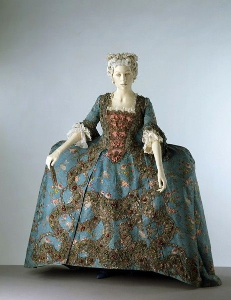 1740-1745 This is a magnificent example of English court dress of the mid-18th century. It would have been worn by a woman of aristocratic birth for court events involving the royal family. The style of this mantua was perfectly suited for maximum display of wealth and art; this example contains almost 10lb weight of silver thread worked in an elaborate 'Tree of Life' Design