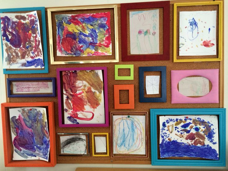 I took recycled frames and painted them with pastel colors and then attached on a cork board to display children's artwork in a way that shows their work is appreciated and respected (Reggio-inspired). - spring 2014 intern Jaclyn Hudak