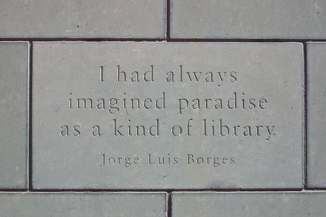 """Paradise    """"I had always imagined paradise as a kind of library""""  Jorge Luis Borges    A brick in the wall at Denver Public Library"""