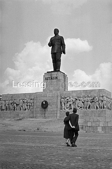 A young couple contemplates the giant Stalin monument on Budapest's Heroes Square.
