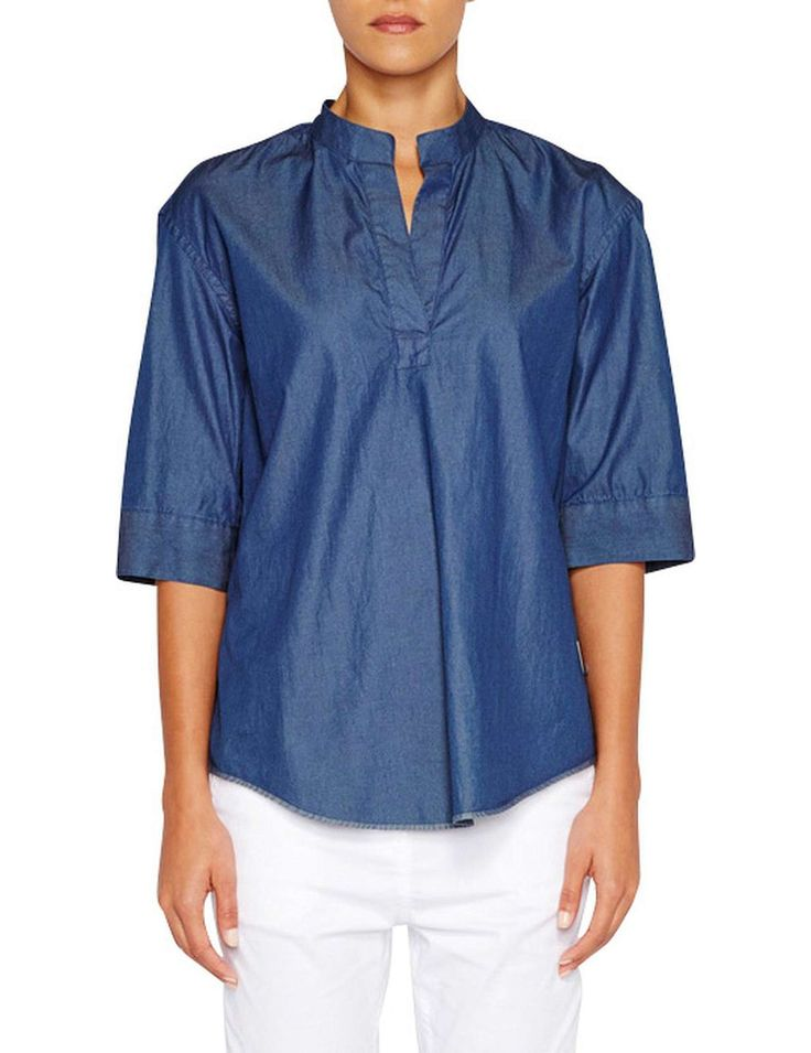 Jac + Jack -  Inspired by traditional Japanese clothing this loose fitting top has a clean stand collar, elegant elbow length sleeves, extra wide cuffs and a refined box pleat yoke. It is made a rich, strong denim of pure Italian cotton.