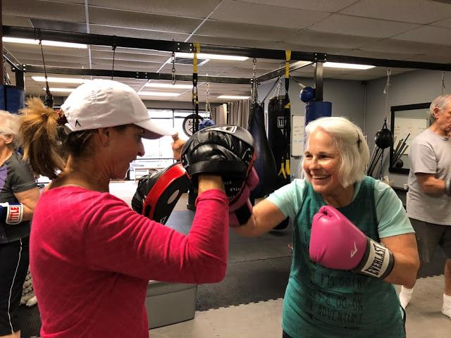 413 Fitness Brings The Fight Against Parkinson S Into The Ring Parkinsons Workout Programs Workout Regimen