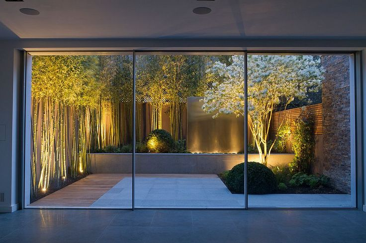 Bamboo, white flowers and a water feature turn this small garden into a showstopper [Design: John Davies Landscape]